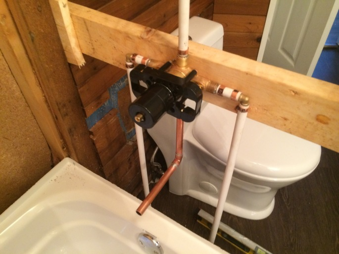Handyman Rob Brown delivers renovates bathrooms in Vancouver, BC, Canada. He carefully measures, cuts and installs wood, tiles, pipes and basic plumbing for toilets and sinks.